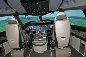 Boeing 787 Dreamliner cockpit. Large LED screens replace more conventional instruments adding to ease of use as well as weight saving.