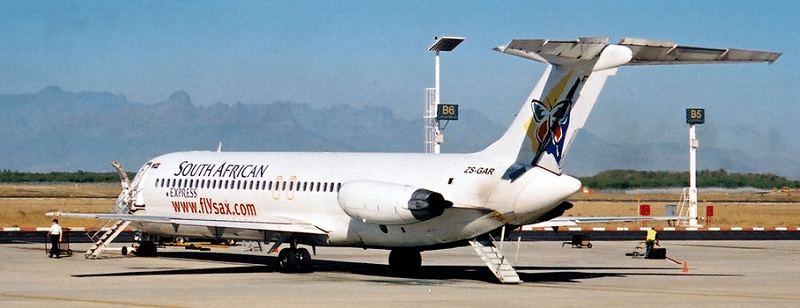 A DC-9-32 of South African Express clearly shows the rear stairway deployed and if you look closely at the front stairs, they can be seen to be attached below the front passenger door. These features plus the A.P.U. (auxiliary power unit), enabled the DC-9 to be autonomous at non-serviced airfields.