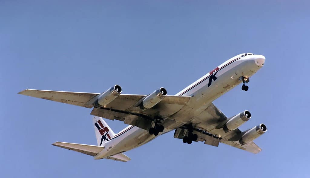 A DC8-62 of cargo airline MK Airlines of Ghana on final approach, showing off its flap configuration.