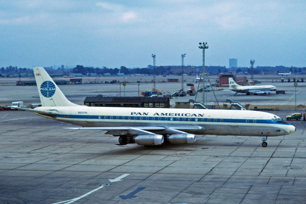 A Douglas DC-8-32 of Pan-American World Airways, registration N801PA sits on the apron at London Heathrow Airport 14 September 1964.