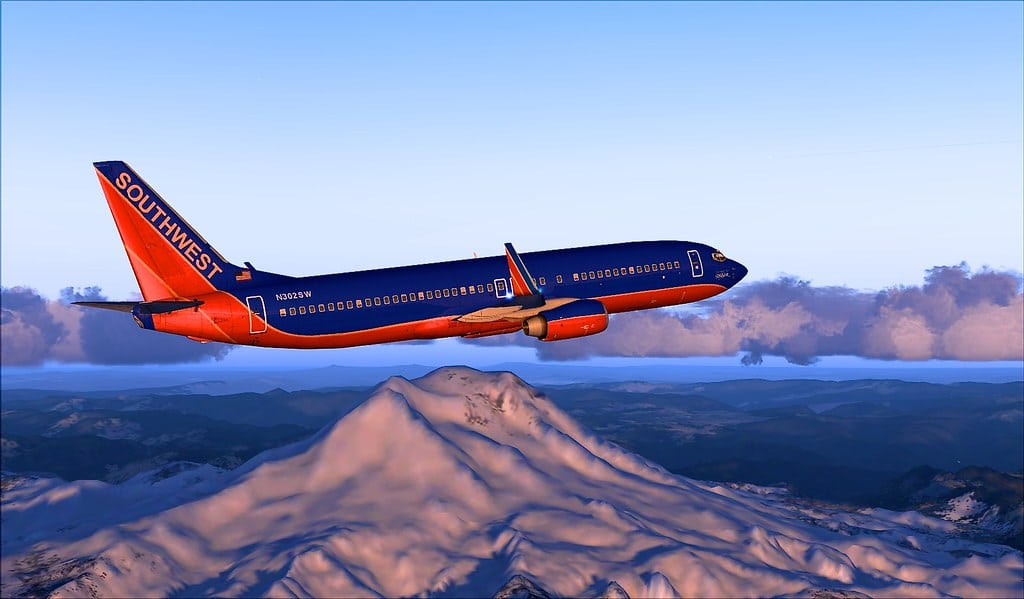 Southwest Airlines 737-800 flying over beautiful landscapes in Flight Simulator.