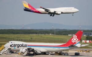 Boeing 747-8i of Asiana flying over a 747-8F of Cargolux