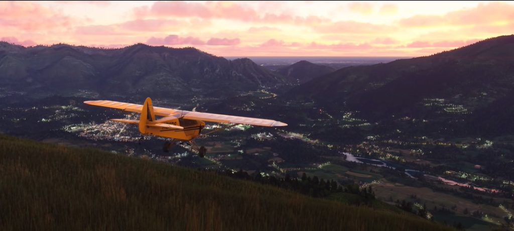 Flight Simulator 2020, a Piper Cub flys over a valley at dawn.